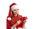 Young woman in red winter hat looking at camera — Stock Photo