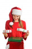 Woman in red santa hat holding present boxes — Stock fotografie