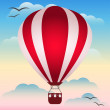 Illustration with bright red colored hot air balloon floating in the sunset sky among the clouds for use in design for card, invitation, poster, banner, placard or billboard cover — Stock Vector #64786599