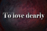 To love dearly text on background — Stock Photo