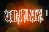 Cinema word on vintage bokeh background, concept sign — Stock Photo
