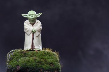Yoda figure and moss. Ecology Concept