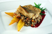 Fish fillet with buckwheat porridge  — Stock Photo