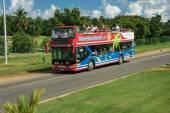 Double decker open top bus on road — Stock Photo