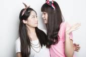 Two smiling asian girls — Stock Photo
