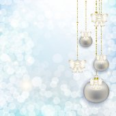 Christmas hanging balls and bows on abstract winter background w — Stock Photo