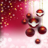 Christmas background with red balls in the bows — Stock Photo