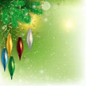 Hanging colored toys on the twig with flying snow on green backg — Stok fotoğraf