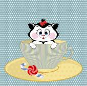 Kitten mug with candy — Stock Photo
