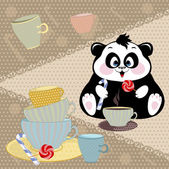 Panda drinking cocoa with candy — Stock Photo
