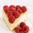 Cake with raspberries on a white plate — Stock Photo #58520387