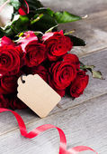 A bouquet of red roses on a  table — Stock Photo