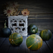Small pumpkins on a wooden surface — Stockfoto #57350179