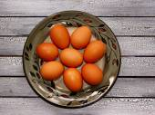 Raw eggs on a plate — Stock Photo