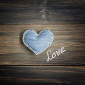 Jeans heart on wooden background — Photo