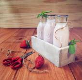 Strawberry milkshake on a rustic wooden table — Stock Photo
