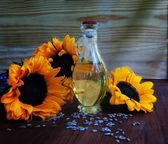 Sunflowers, pasta, tomatoes, basil and a bottle of oil, wine  — Stock Photo
