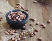 Bowl with raw beans in a rustic style — Stock Photo