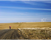 Motorcycle riding towards Group of Wind Mills — Foto de Stock