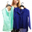 Woman keeps two blouses and can't choose the one for her — Stock Photo #60206491