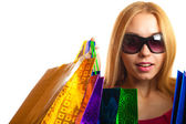 Portrait young adult girl with colored bags — Стоковое фото