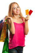 young woman holding gift  cards and shopping bags — Stock Photo