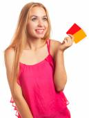 young woman holding gift cards — Stockfoto