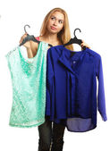 Woman keeps two blouses and can't choose the one for her — Stock Photo