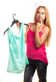 Woman keeps blouse and doubt to buy or not — Stock Photo