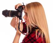 Glamour woman-photographer takes images - isolated on white — Stock Photo