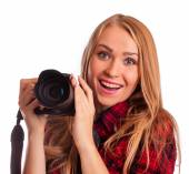 Female photographer holding a professional camera - isolated ove — Stock Photo