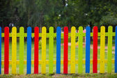 Colorful fence around a playground for children — Stock Photo