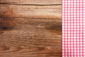 Wooden board with a checkered tablecloth — Stock Photo