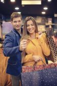 Couple in a boutique — Stock Photo