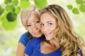 Elderly and a young women — Stock Photo