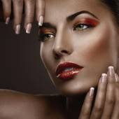 Woman with fashion red nails and sensual lips — Stock Photo