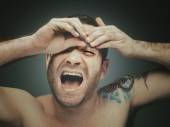 Tattoed man plucking eyebrows — Foto Stock