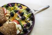 Two Sandwiches with Salad on a Brown Plate — Stockfoto