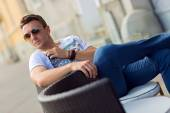 Sexy fashion man model dressed casual posing outdoor — Stock Photo