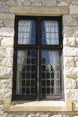 Leaded window in stone wall — Stock Photo