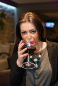 Beautiful girl with red wine. — Stock Photo