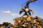 Big crane dropped scrap on pile — Stock Photo