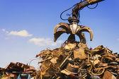 Big crane dropped scrap on pile — Stock Photo