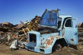 Oldtimer on junkyard. — Stock Photo