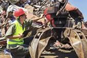 Worker inspect crane on junkyard. — Stock Photo
