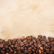 Coffee beans line the old sheet of paper — Stock Photo #68518205