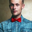 Emotive prtrait of a handsome hipster male model with in trendy — Stock Photo #54071239