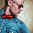 Eyewear concept. Handsome male model with in trendy glasses, jea — Stock Photo #54071241