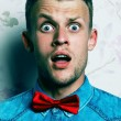 Shocked face concept. Fashion portrait of a surprised hipster yo — Stock Photo #54071273