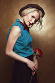 Vintage portrait of young beautiful blonde hipster girl with red — Stock Photo